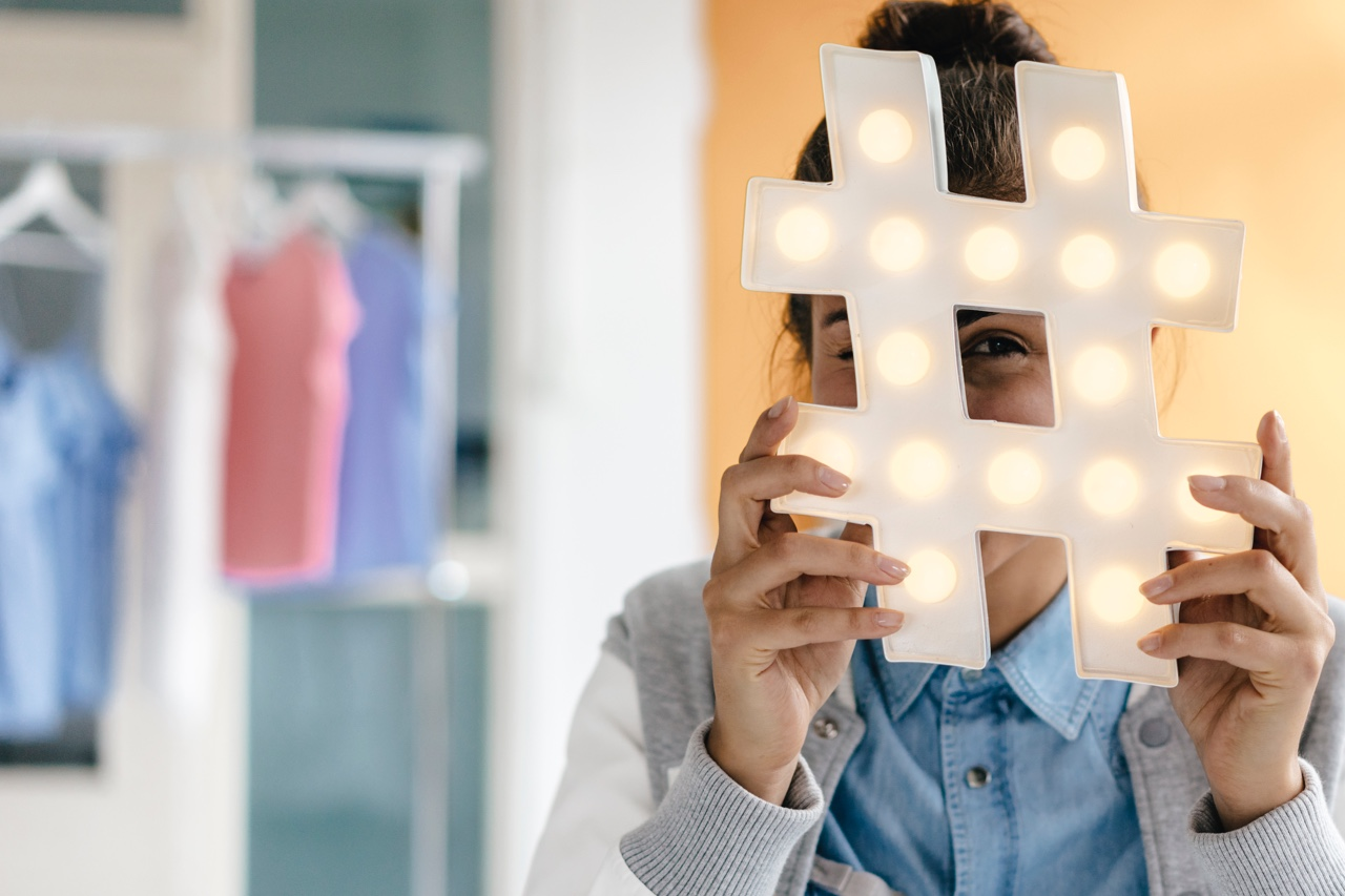 A woman with a hashtag