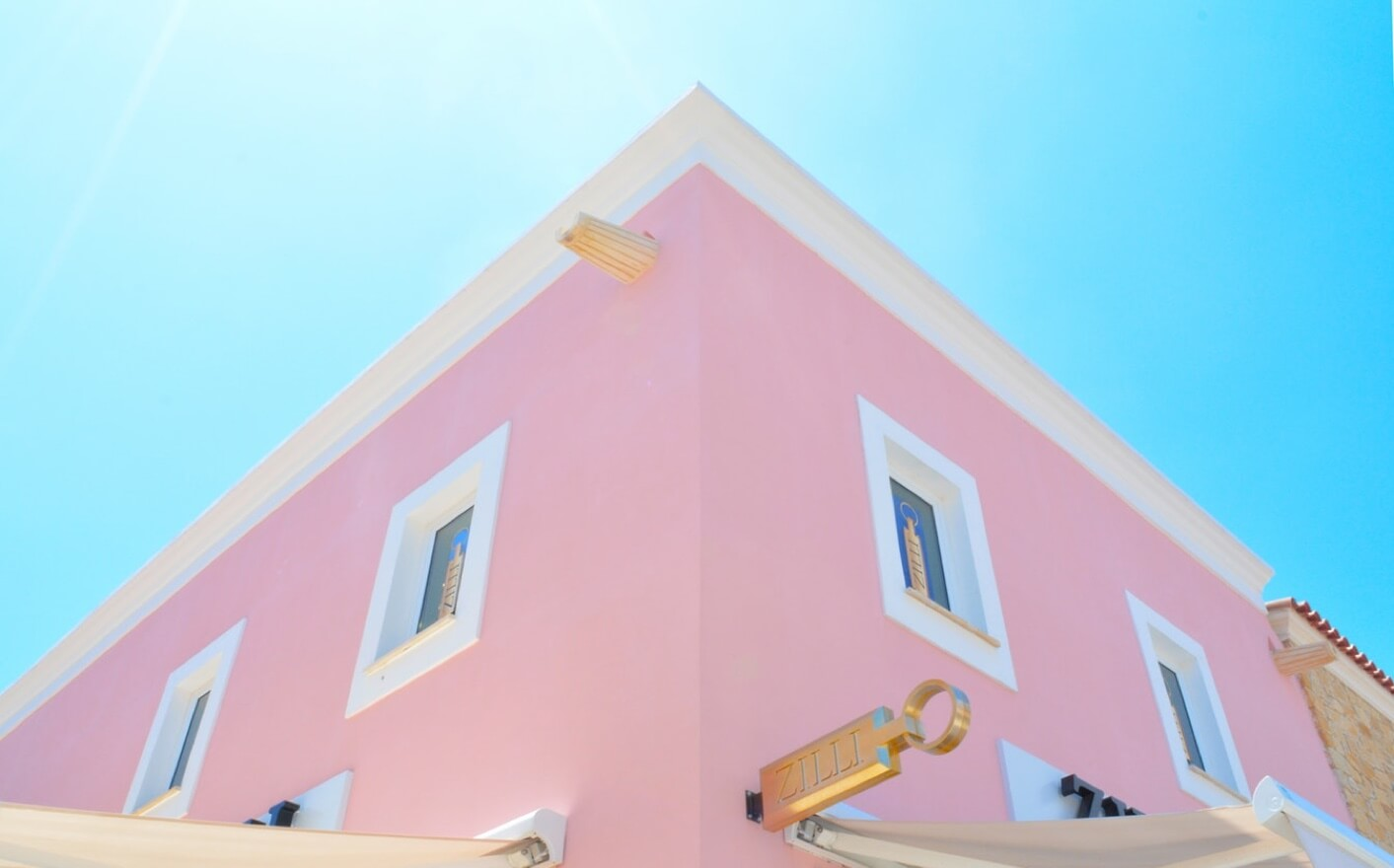 pink house and blue sky